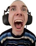Persona en el grito de los auriculares Imagenes de archivo