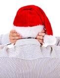 Persona en Santa Hat Imágenes de archivo libres de regalías
