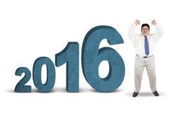 Persona gorda feliz con los números 2016 Imagen de archivo libre de regalías