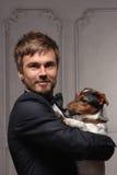 Persona joven con su perro Imagen de archivo libre de regalías