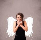 Persona linda con las alas ilustradas ángel Imagen de archivo