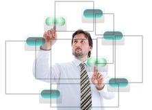 Persona masculina joven que presiona los botones digitales Fotos de archivo libres de regalías