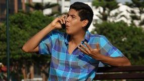 Persona que habla en el teléfono Foto de archivo libre de regalías