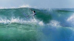 Persona que practica surf abstracta fotos de archivo