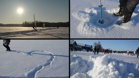 Persona que practica surf del hielo Forma del corazón en nieve Taladro de Icehole Patín de la gente almacen de metraje de vídeo