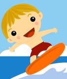 Persona que practica surf del muchacho en la onda Fotos de archivo libres de regalías