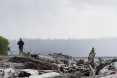 Persona que se ejecuta en la playa Fotos de archivo libres de regalías