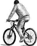 Persona su una bicicletta Fotografia Stock Libera da Diritti