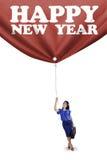 Persona y un texto de la Feliz Año Nuevo Fotos de archivo libres de regalías