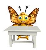 personagem de banda desenhada da borboleta do divertimento com tabela e cadeira Imagens de Stock Royalty Free