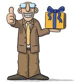 Personaggio dei cartoni animati con il regalo a disposizione Fotografia Stock