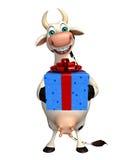Personaggio dei cartoni animati della mucca di divertimento con il contenitore di regalo Immagine Stock