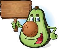 Personaje de dibujos animados del aguacate que lleva a cabo la muestra de madera Imagenes de archivo