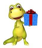 Personaje de dibujos animados del dinosaurio de la diversión con la caja de regalo Imagen de archivo libre de regalías