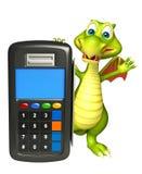 Personaje de dibujos animados del dragón de la diversión con la máquina del intercambio Imagen de archivo libre de regalías