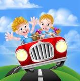 Personajes de dibujos animados que conducen el coche Foto de archivo libre de regalías