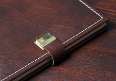 Personal. Diary in leather, on a wooden background Royalty Free Stock Image