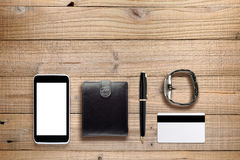 Personal accessories on wood Royalty Free Stock Images