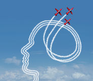 Personal Achievement. And career aspiration concept as a group of acrobatic jet airplanes performing an air show creating a human head shape for business vision Stock Photography