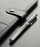 Personal agenda. Close-up of a black personal agenda and with a pen with selective focus Royalty Free Stock Photo