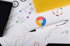 Personal agenda, graphic charts and cellphone Stock Photography