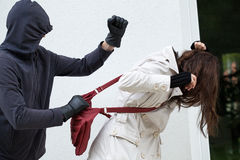 Personal assault. A personal assault on a passer-by with a red bag Stock Images