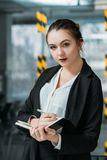 Personal assistant portrait business matter notes. Personal assistant portrait. Business matters planning. Young woman making notes listening to virtual boss stock photography