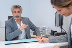 Personal assistant taking notes from manager. Manager royalty free stock images