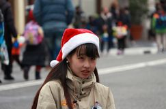 Personal av universella studior, Japan pålagd som jul Cap, när det att närma sig jultidberöm Arkivfoton