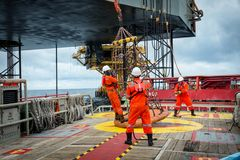 Personal basket tranfer form supply boat to oil&gas rig offshor. E during crew change by boat stock photo