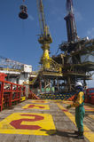 Personal basket transfer at oil platform. Workers are lifted by the crane to the offshore platform, Transfer crews by personal basket from the platform to crews Stock Images