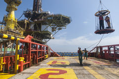 Personal basket transfer at oil platform. Workers are lifted by the crane to the offshore platform, Transfer crews by personal basket from the platform to crews Royalty Free Stock Images