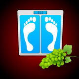 Personal bathroom scale with grape for diet or hea Stock Photo
