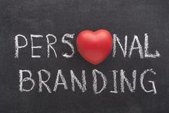 Personal branding heart. Personal branding phrase handwritten on blackboard with heart symbol instead of O stock images