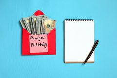 Personal budget, financial concept. US dollar banknotes in the red envelope and sticker budget planning royalty free stock image