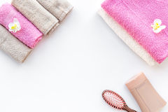 Personal care. Towels, soap and shampoo, cobs on white backgrond top view copyspace Stock Images