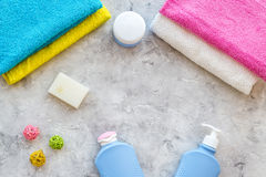 Personal care. Towels, soap and shampoo, cream on grey stone backgrond top view copyspace Royalty Free Stock Photos