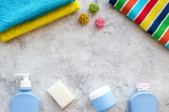 Personal care. Towels, soap and shampoo, cream on grey stone backgrond top view copyspace Stock Photography