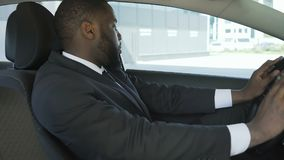 Personal chauffeur awaiting his chef and singing in car, man spying from auto. Stock footage stock footage