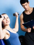 Personal coach controls sports actions of woman Royalty Free Stock Images