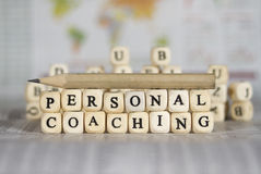 Personal coaching. Word on newspaper background Royalty Free Stock Photo