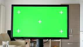 Personal computer with big green screen chroma mock-up. On the table in living room of the house. Dolly slider 4K footage stock video footage