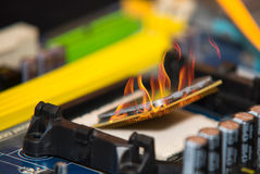 Personal computer CPU on fire Royalty Free Stock Photography