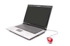 Personal computer and red mouse. Over white Royalty Free Stock Images