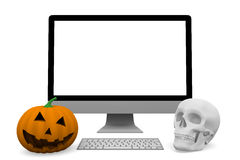 Personal computer with skull and halloween pumpkin Stock Images
