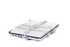 Personal computer tied by chain. Isolated in white Royalty Free Stock Photo