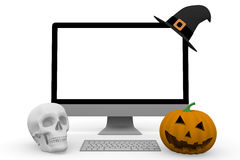 Personal computer with witch hat skull and halloween pumpkin Stock Photos
