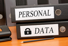 Personal Data - Data Security. Two binders with text on desk in the office stock image