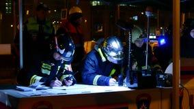 Personal del servicio de rescate ruso en el punto del comando Imagen de archivo