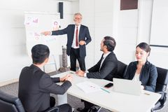 Personal development, coaching and training course for Business teamwork. Meeting and discussing with colleagues in conference room stock image